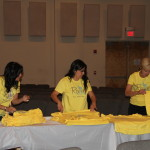 Passing out Revive volunteer shirts  3/2012